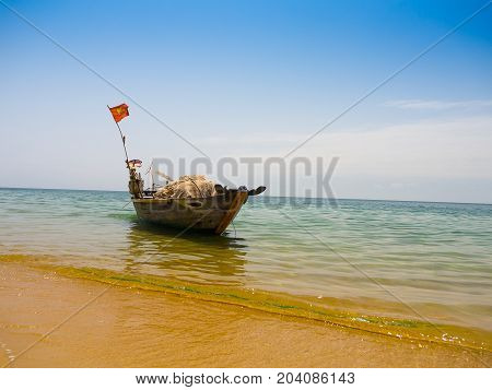 Beautiful view of a boat in the water in a sunny day, in Vietnam. Hoian is recognized as a World Heritage Site by UNESCO.