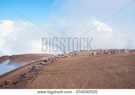 barren summit of pikes peak at last stop of historic cog railway in colorado usa