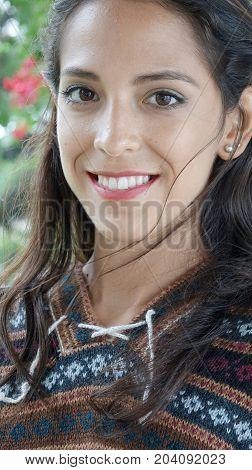 Hispanic Female And Beauty Wearing a Knit Sweater