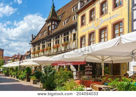 Obernai France - July 17 2017: Cafes and restaurant in Petite-France in Strasbourg Traditional colorful houses in La Petite France Strasbourg Alsace France