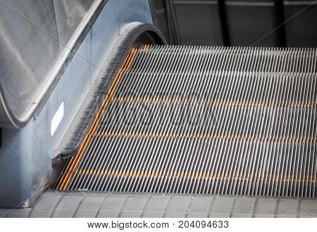 Close up of steps of moving business escalator.
