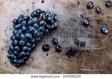 Bunches Of Fresh Ripe Red Grapes On A Metal Textural Surface Background. Dark Grapes, Blue Grapes, W