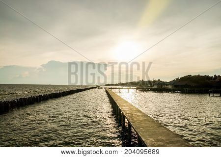 sihouette concrete walkway for seaview in sunset with soft sunlight