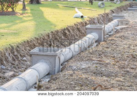 Concrete pipe on construction site soil background