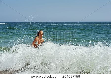 beautiful slender woman in swimsuit at sea. Beach sea travelling.