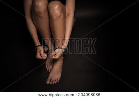 concept human traffickinghand girl in shackle on isolate black background