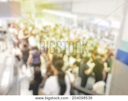 Blurred Image Of Crowd Of Anonymous People Standing And Waiting At Indoor Train Station In Rush Hour