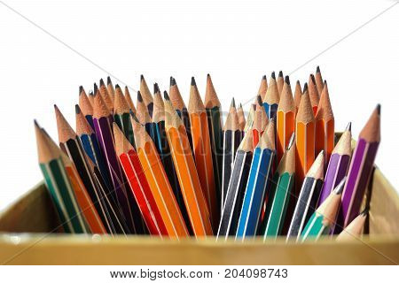 color pencils in a bunch on white background
