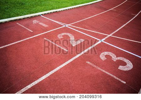 A red track field for running in a stadium