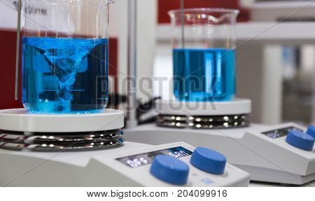 the Beakers on magnetic stirrer in lab