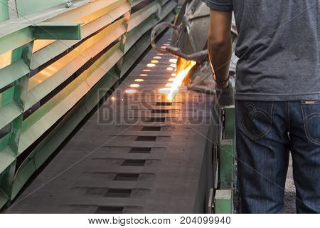 Iron molten metal is poured in sand mold;focus at sand mold