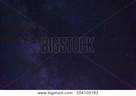 Night landscape with colorful Milky Way. Beautiful Universe. Space background Close-up of Milky way galaxy with stars and space dust in the universe Long exposure photograph.