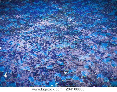 Background of rippled water in swimming pool (swimming, pool, wave)