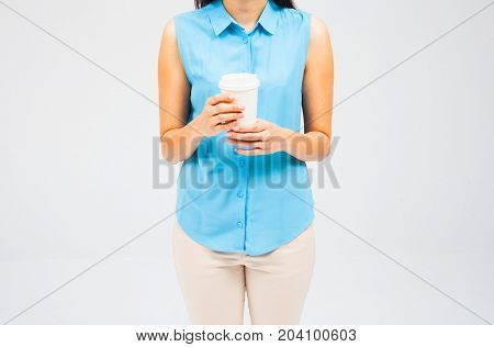 Hot drink in paper cup in hands