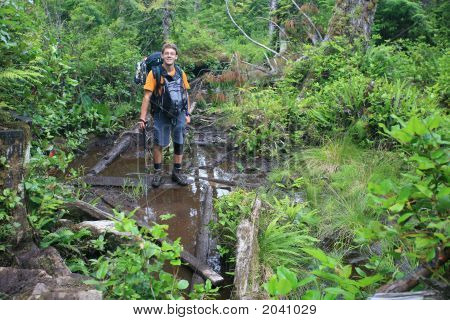 Hiker In The Mud On West Coast Trail #2