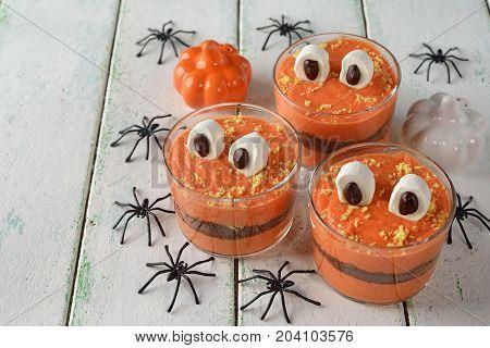 Funny dessert monster for Halloween on a white background