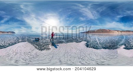 Tourist With Sleds Walks Along The Blue Ice Of Lake Baikal. Spherical 360 Degrees 180 Panorama