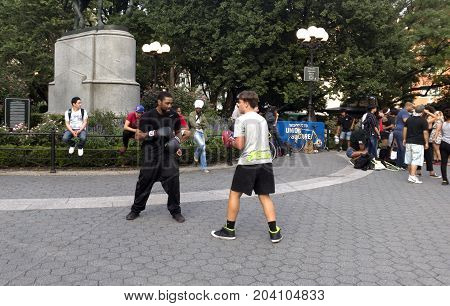 NEW YORK NEW YORK USA - AUGUST 25: Two men practice boxing in Union Square park and 14th street. Taken August 25 2017 in New York.
