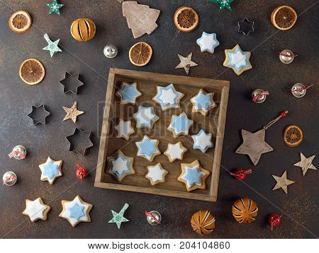 Christmas cookies decorated with sugar mastic on a gray background