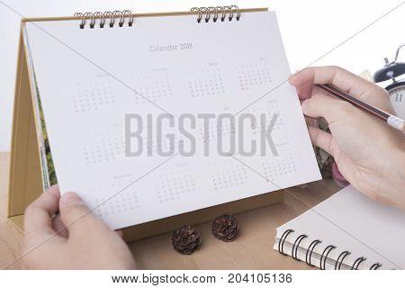business hand list Calendar 2018 Planner meeting on desk office. organization management remind concept.