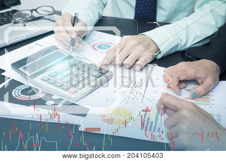 business accountant with document graph financial and calculator on office table. concept planning budget and audit.