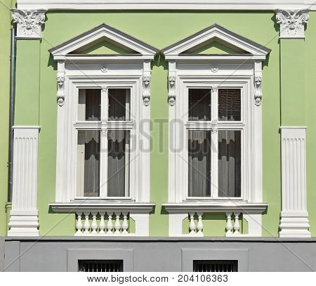 Ornate windows of a house in the city