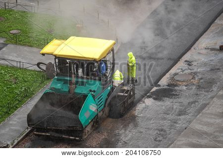 in the yard doing a road made of asphalt