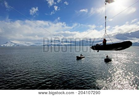 Inflatable boat cruising on the ocean, Antarctic Peninsula, Antarctica