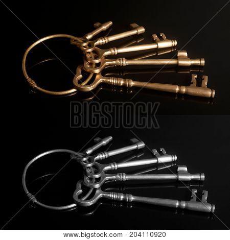 Old keys on a keyring on black background