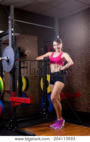 sport woman with barbell in the gym