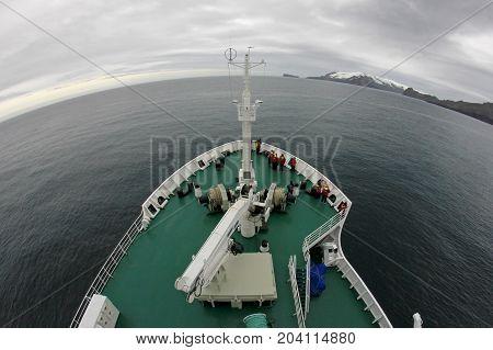 Cruise ship cruising to Deception Island, fisheye perspective, Antarctica
