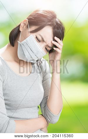 woman feel headache on the green background