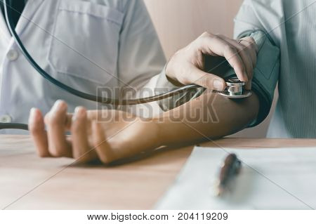 Doctor Using Stethoscope Take A Tap On The Patient's Arm.