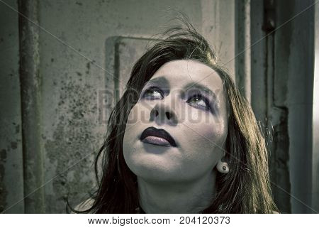 emo girl with beautiful hair on Grunge background