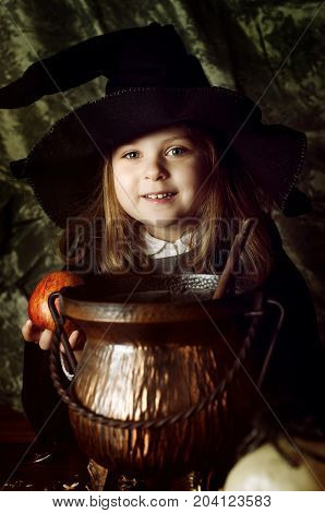 Close-up portrait of little caucasian girl in with costume with apple
