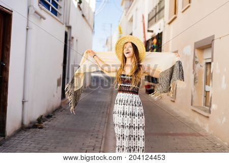 Young beauty woman in hat laughing,smiling,walking.Summer vacations,emotional