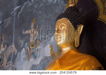 CHIANGMAI THAILAND - JULY 26: Details of golden buddha statue with tales of the lord Buddha's former births behind at Wat Phra That Doi Suthep Temple on July 26 2014 in ChiangmaiThailand.
