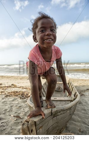 March 11 2015 Sambo Creek Honduras: a young garifuna girl part of the fishing community on the carribbean coast of the country stands on a dugout canoe