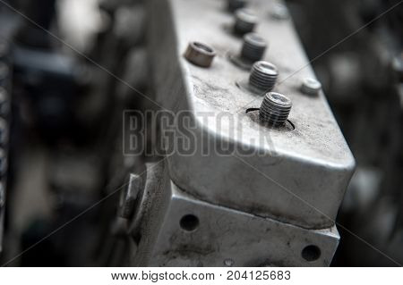 A close-up of an old mechanical high-pressure diesel pump. The shallow depth of the sharply depicted space