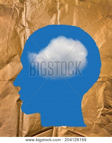 Crumpled paper shaped as a human head blue sky and white cloud inside head. Positive and imagination concept.