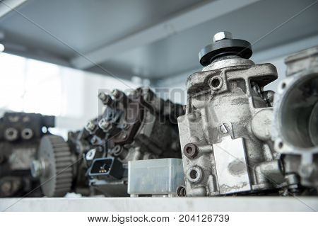 Close up The disassembled mechanical high-pressure diesel pump. Components of the mechanism. Service of maintenance of diesel equipment