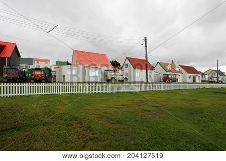 Brithis cars in front of typical british town houses in Port Stanley, Falkland Islands, Islas Malvinas