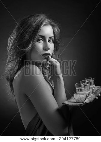 Blonde Woman With Glasses Of Tequila .