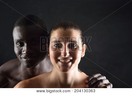 Portrait of a couple on a black background