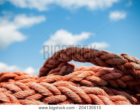 Red rope close up under a blue sky