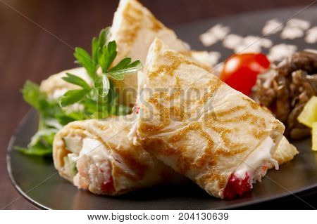 rolled pancakes stuffed . Shallow depth-of-field.  close up   cooking meal