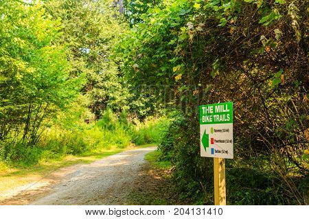 A Sign for Bike Trails Through Woods