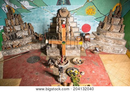 February 3 2015 San Pedro la Laguna Guatemala: interior of a shaman ritual praying room with ancient statues and Mayan cross