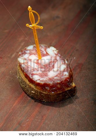 Canape with salami .  Shallow depth-of-field. close up
