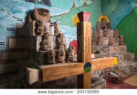 February 3 2015 San Pedro la Laguna Guatemala: shaman praying room with Mayan cross in the foreground